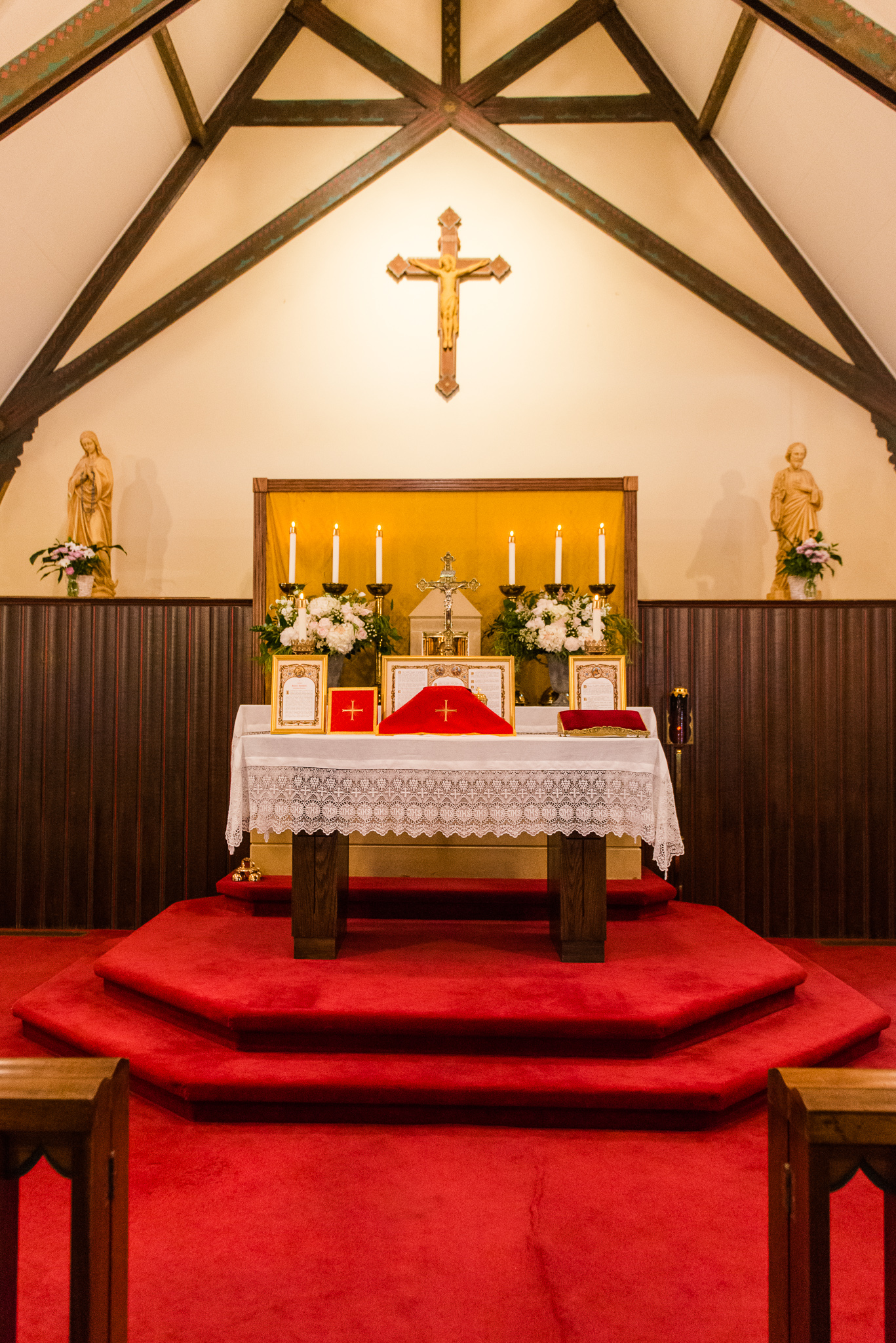 The altar set for a Traditional Latin Mass Catholic wedding in the Chapel of Immaculate Conception in Leesburg, Northern Virginia