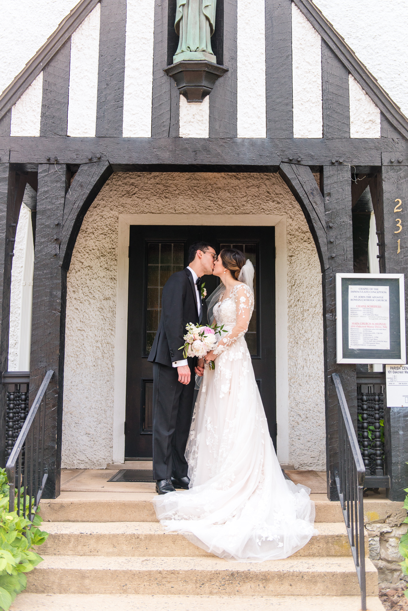 A traditional Catholic bride and groom share their first kiss as husband and wife outside the Chapel of Immaculate Conception in Leesburg, Northern Virginia