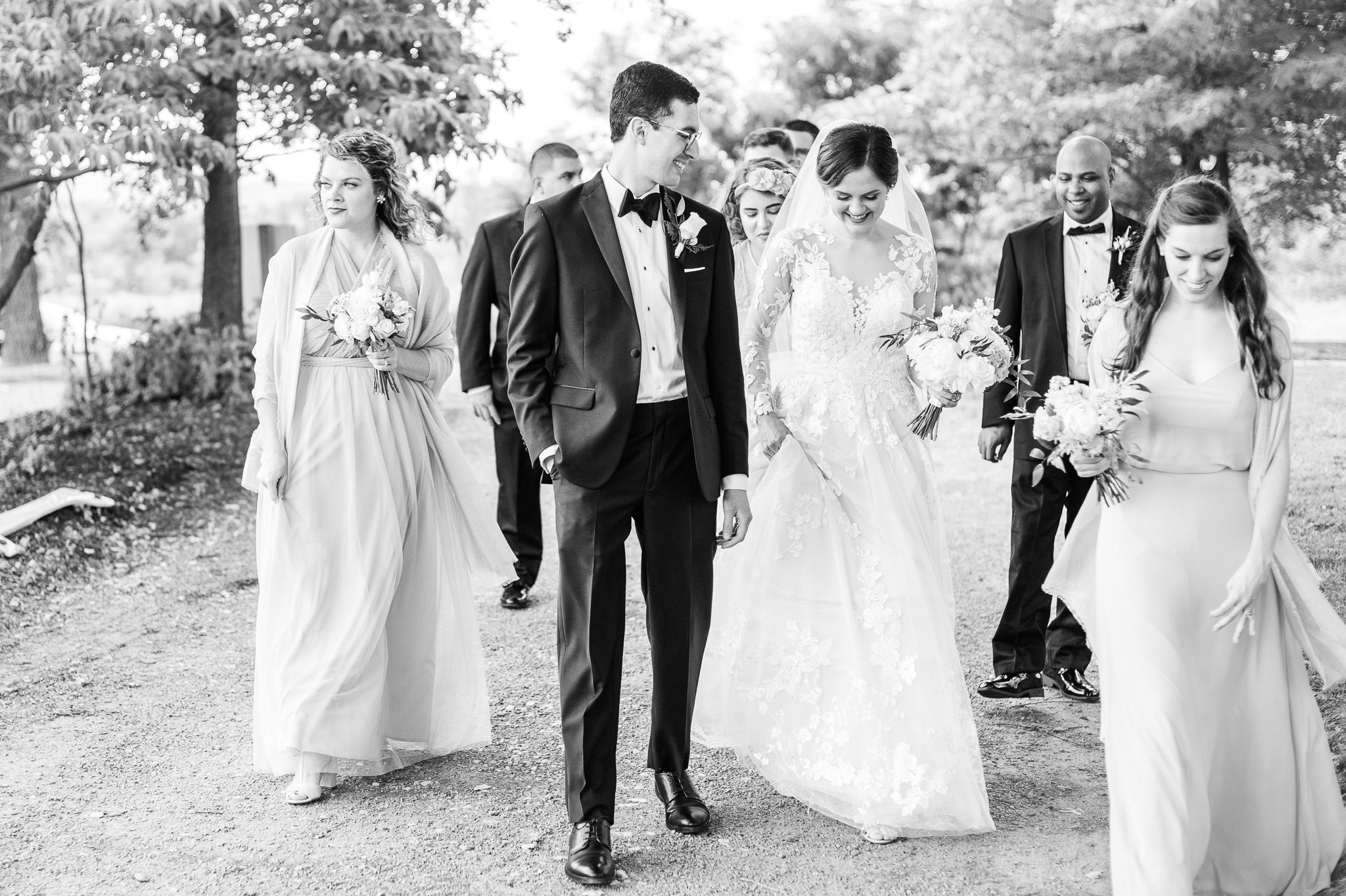 A bridal party walking together to a reception at The Barns at Hamilton Station Vineyard in Leesburg, Northern Virginia