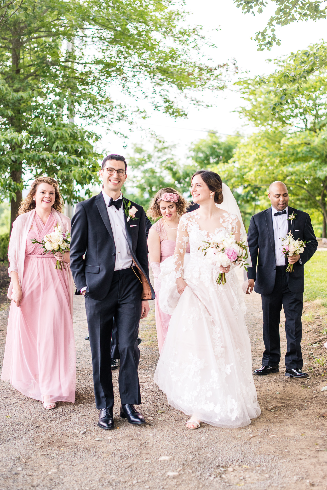 A bridal party walking together to a reception at The Barns at Hamilton Station Vineyard in Leesburg, Northern Virginia