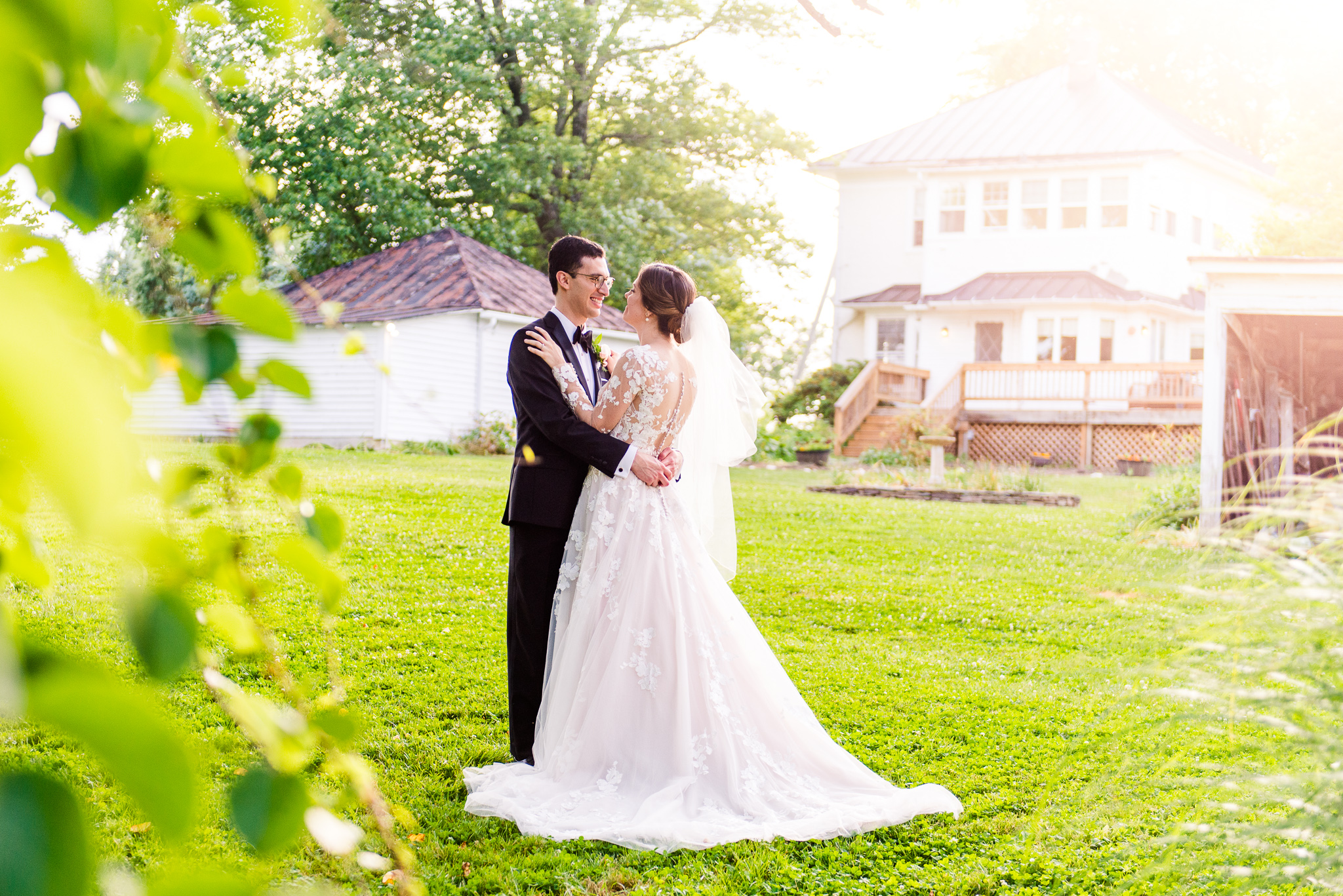 A bride and groom embrace during golden hour at The Barns at Hamilton Station Vineyard in Leesburg, Northern Virginia