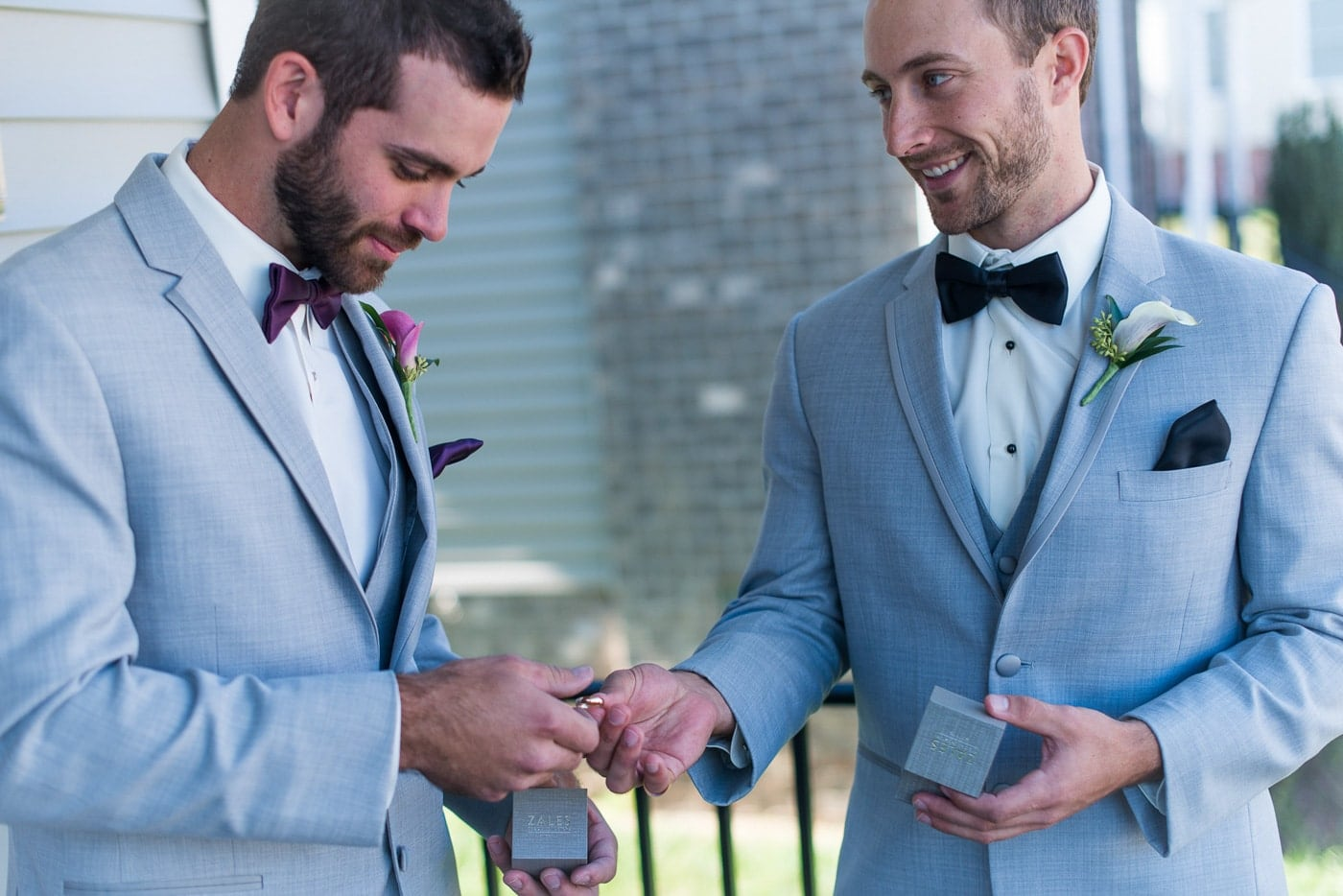 Groom Handing Off The Rings to The Best Man