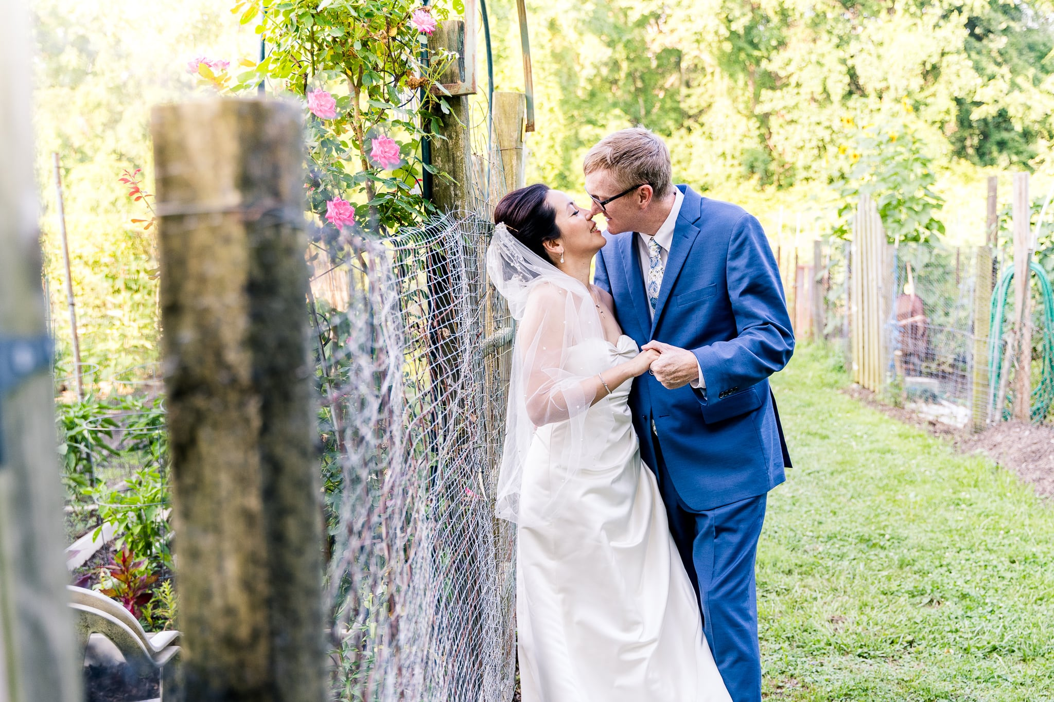 A Taiwanese bride kisses her groom in the community gardens at Nottoway Park after their wedding in Vienna, Northern Virginia