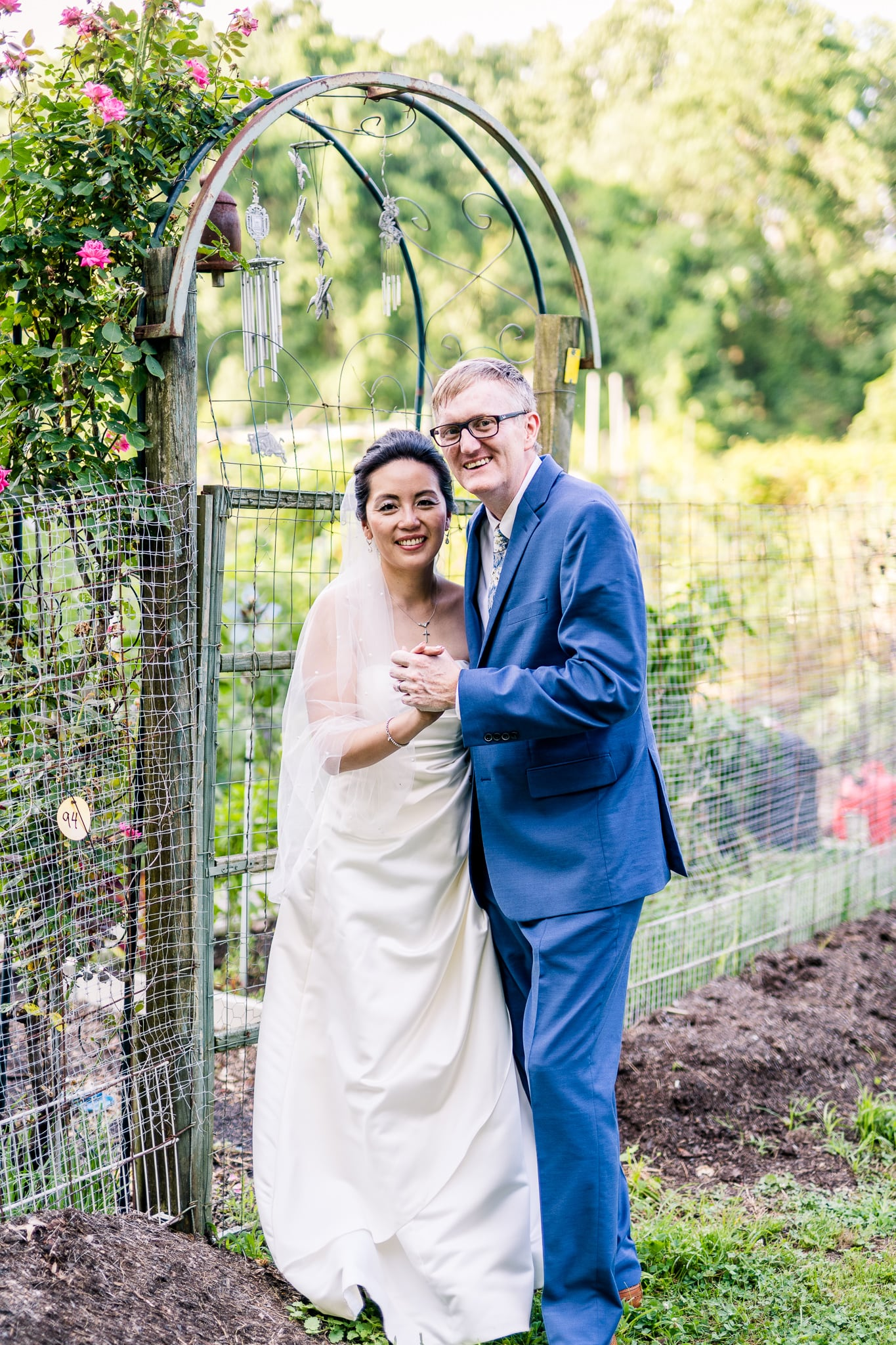 A Taiwanese bride poses with her groom in the community gardens at Nottoway Park after their wedding in Vienna, Northern Virginia