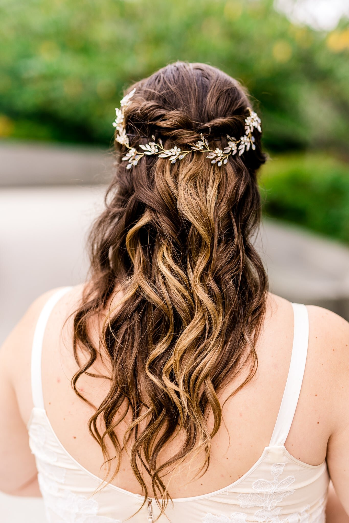 Details of a bride's hair featuring a bridal hair vine hairpiece on her wedding day at the Tidal Basin near the MLK Memorial in Washington, DC