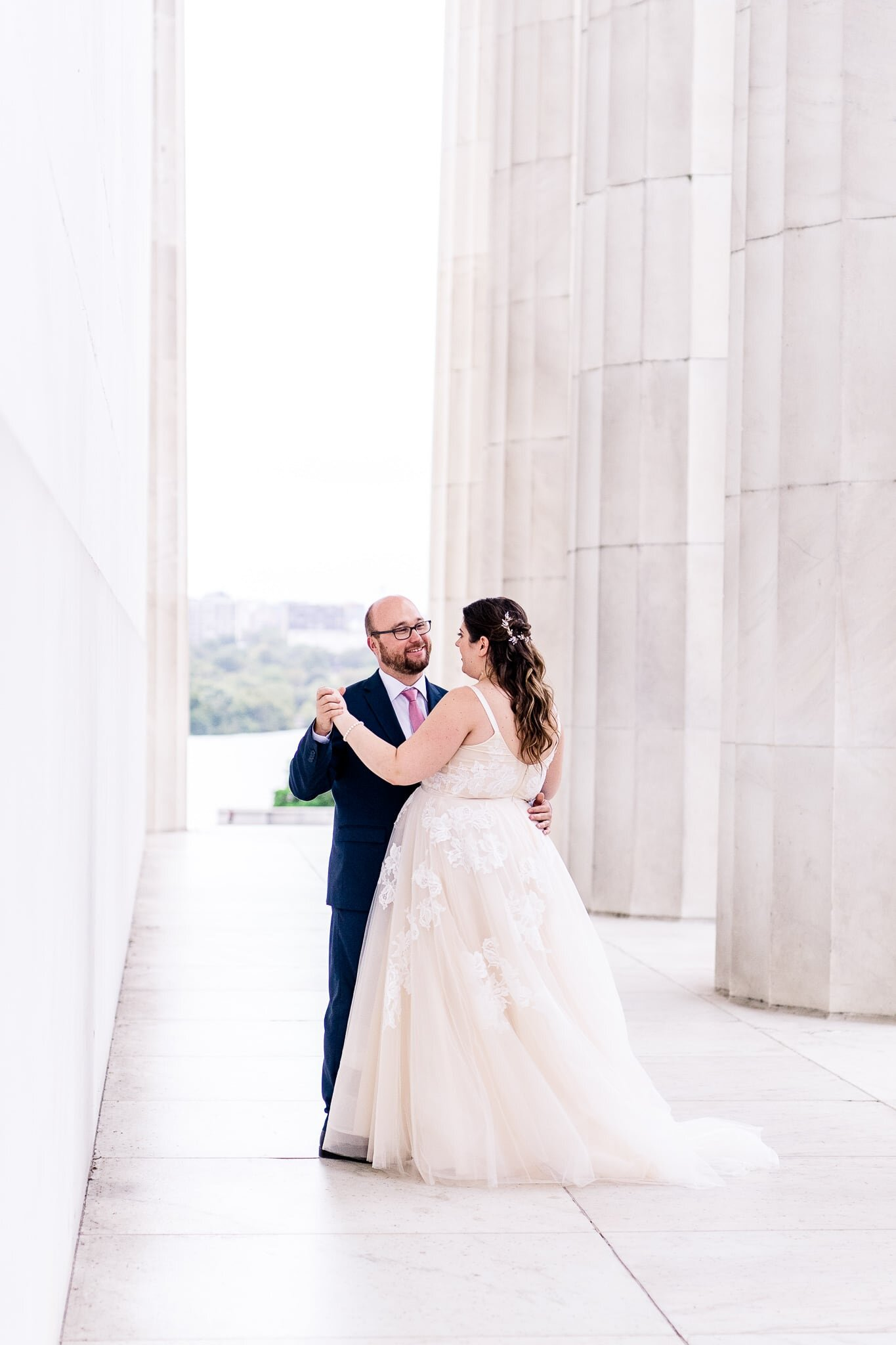A bride and groom dance together on their wedding day at the Lincoln Memorial in Washington, DC