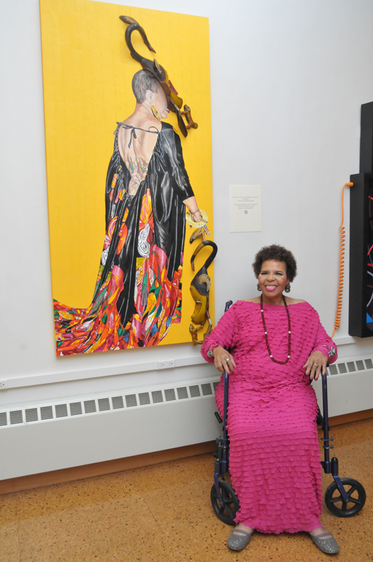 Ntozake Shange with one of the artworks at the exhibit. (Jet Magazine)