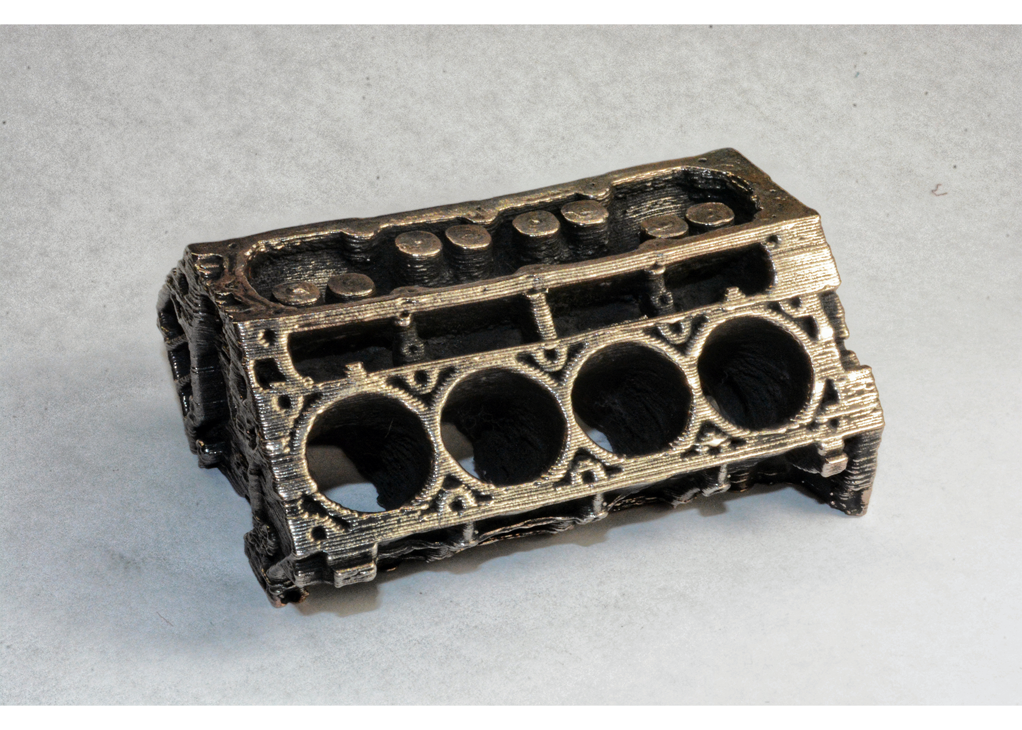 bronze 3d printed metal engine part printed on a desktop printer