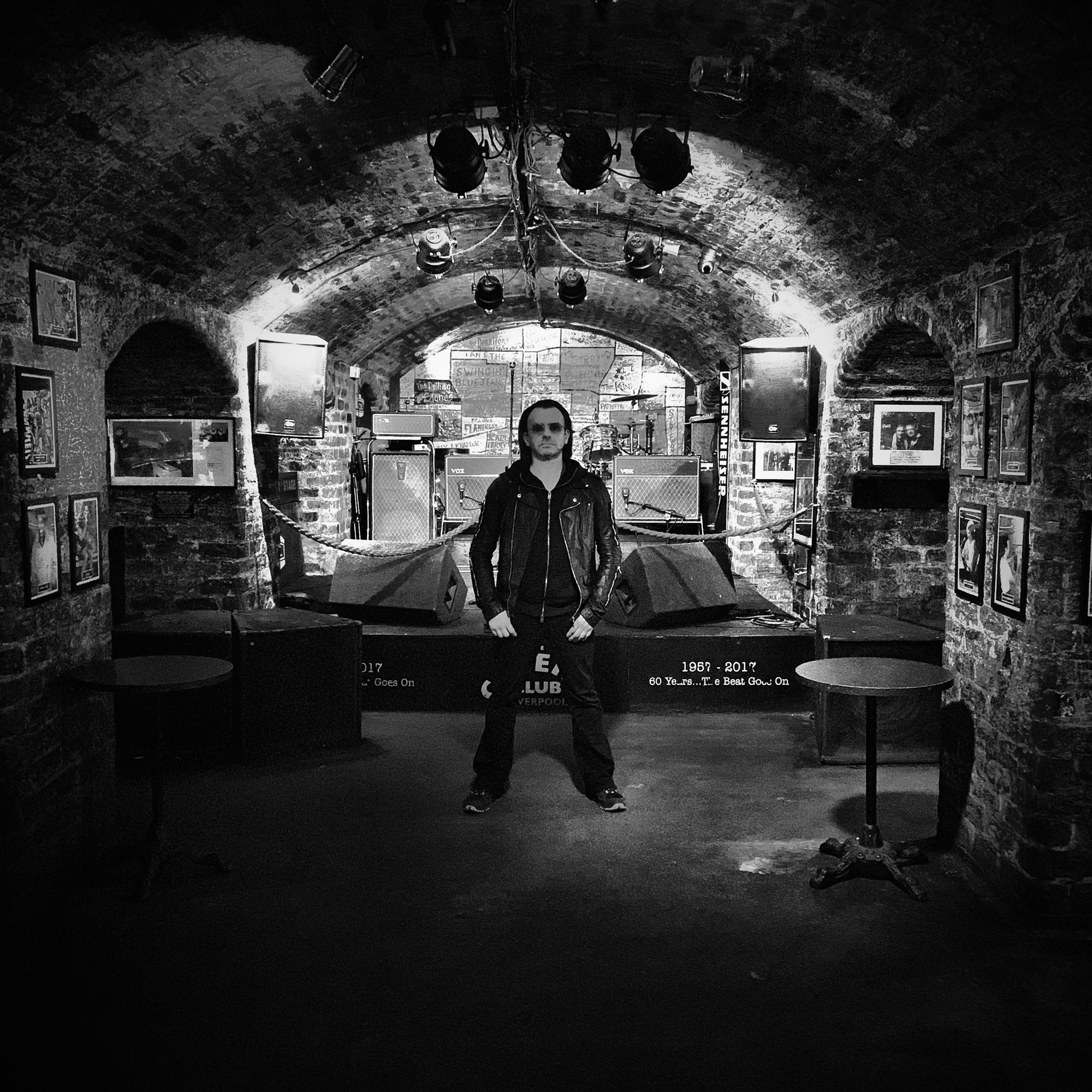 The singer from U2Baby in the main area of the Cavern adjacent to the bar, memorabilia store and the Cavern Live Lounge where U2Baby would play