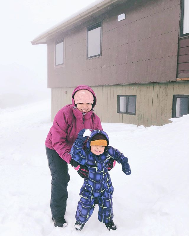 "Another one because I can't resist his little fist clutching a mangled snowball ready to throw and his totes radical rented snowsuit. Meanwhile I'm looking slightly terrified wondering ""Is this the step that will result in me sinking knee deep into the snow?"" 🙃🌨❄️☃️ Pic by brill @petamazey who kept a fire going at our Air BnB for a full three days."