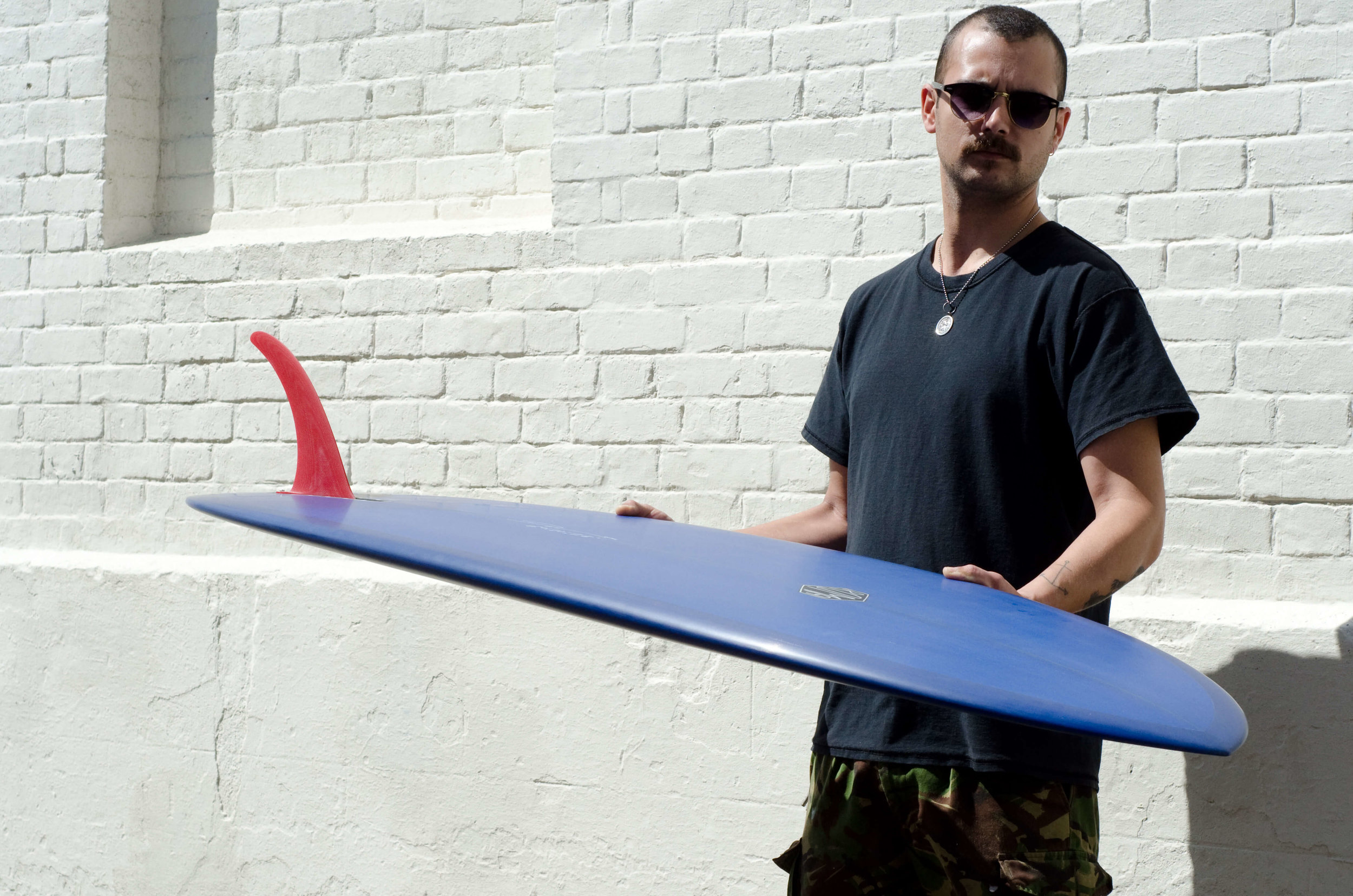 """""""We are a vehicle for connecting people with the custom process"""" - Clyde is a smooth, connect the dots single fin. The rails are pinched and the roll in the belly is just right. It's how we like our midlenghts with the widepoint forward and a pulled in tail."""