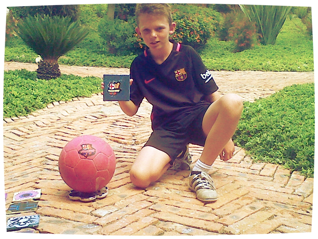 Connor, Age 9 - At Picasso art workshop at Rosewood, you can do whatever your heart tells you, so Connor, age 9, painted his favorite Barcelona soccer team's logo on his ball and a tile!Photo by the Children's Art Foundation A.C