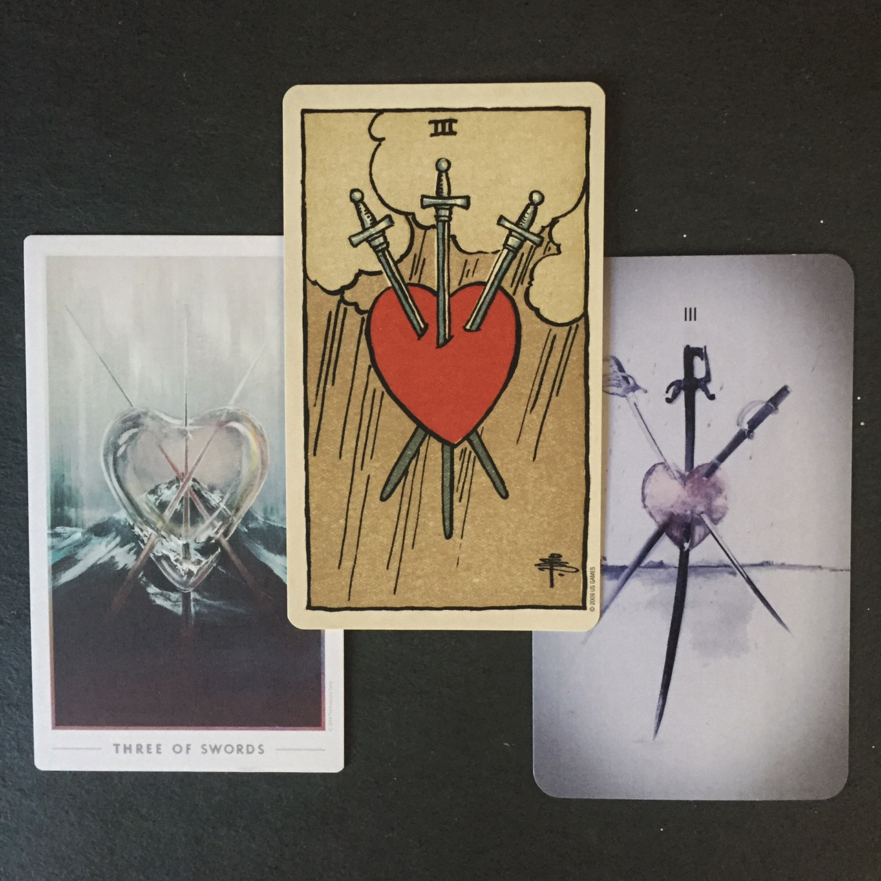 Cards from Left to Right:  The Fountain ,  R-W-S , and  Mountain Dream  Tarots