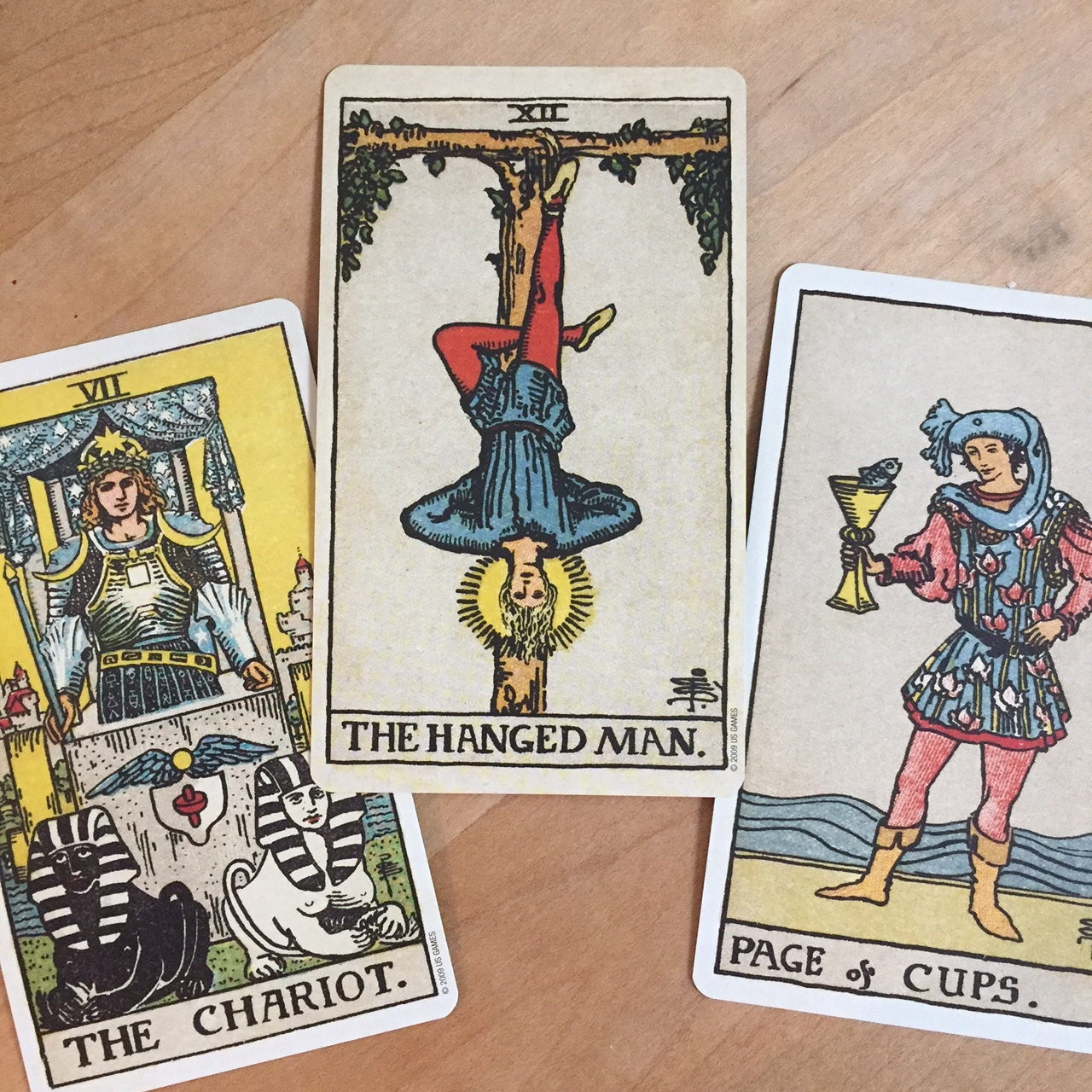Tarot reading with Rider-Waite deck Page of Cups The Chariot and The Hanged Man