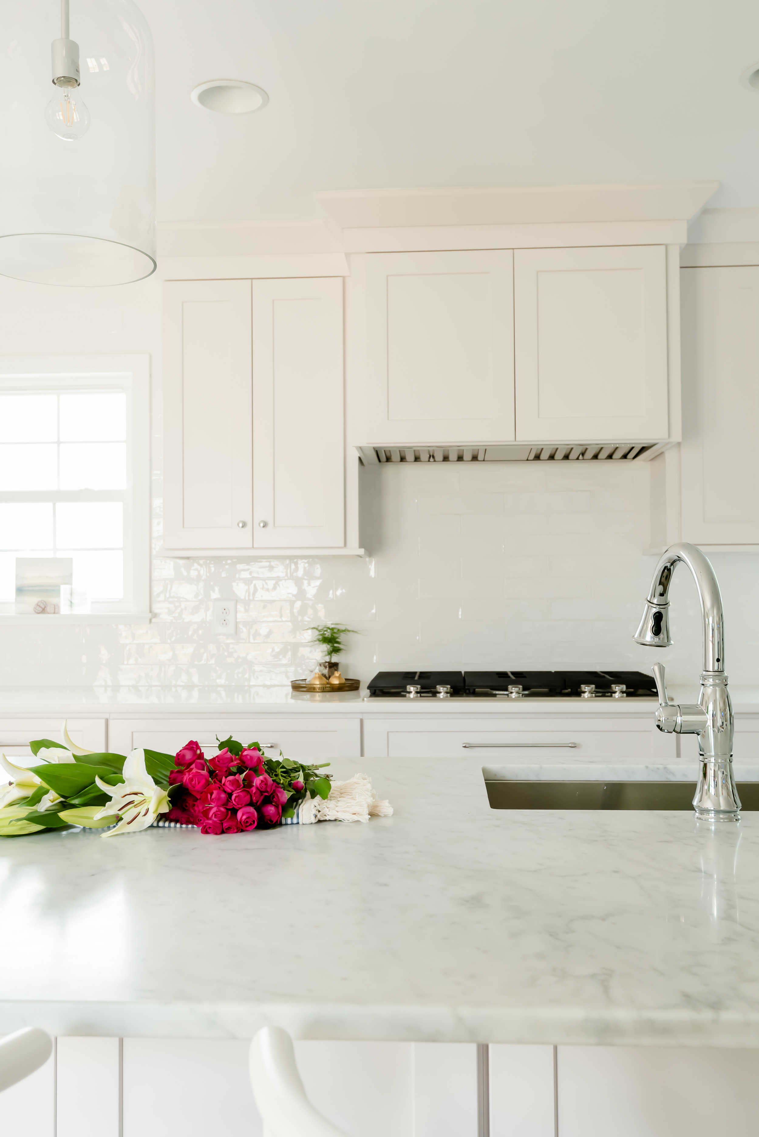 carrara marble was used for the island countertops and we used a quartz (caesarstone in blizzard) for the rest of the countertops.