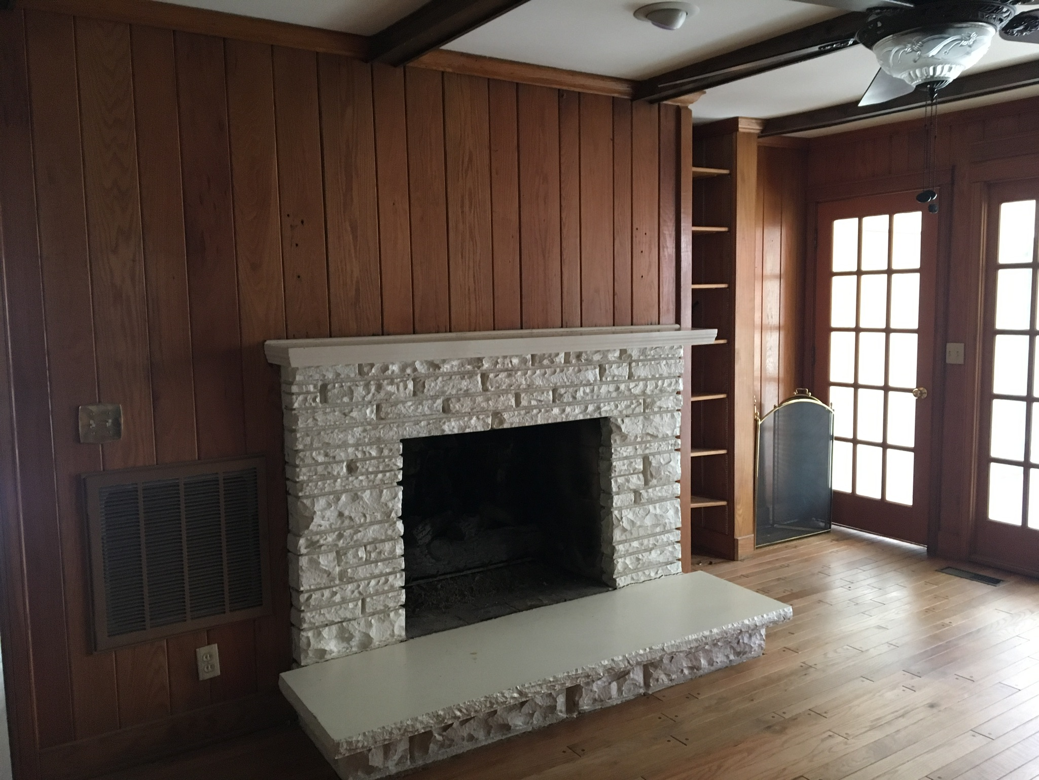 who knew that there was a beautiful fireplace behind all of that stone and paneling.