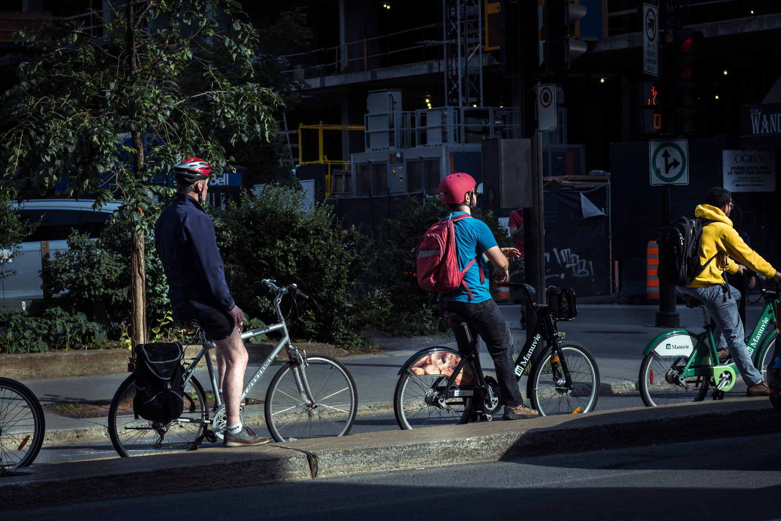 The summer fills the downtown streets with cyclists.
