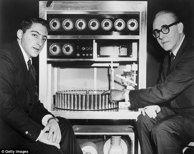 US film producer Mike Todd Jr (left) sits in 1959 with Swiss inventor Hans Laube (right), who points to his Smell-O-vision machine, which made smells in synchronization with action in the film Scent of Mystery