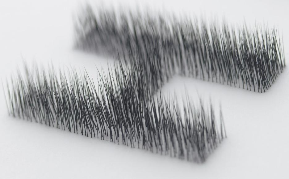 Haptic Logo. Animal hairs on silicone.Takeo Paper Show - Kenya Hara (2004)