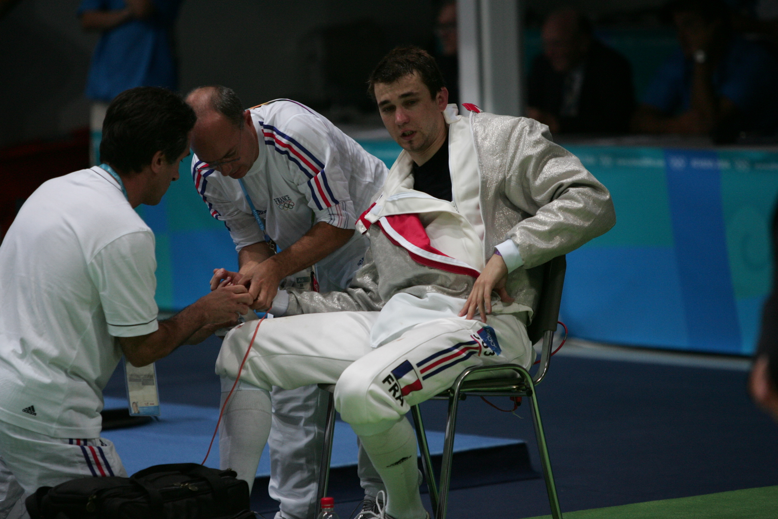 Damien Touya's hand being bandaged in Men's Sabre Semi-Final - USA France - Athens Olympics