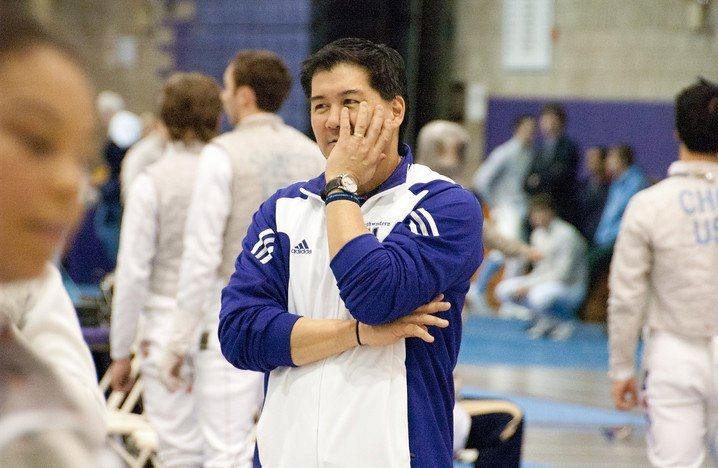 Ed Kaihatsu, former Associate Head Fencing coach at Northwestern University, coaching at a NCAA fencing competition