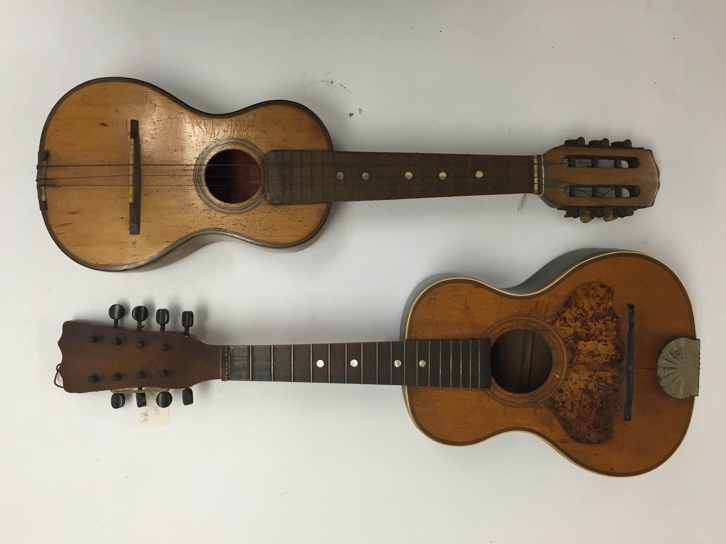 A child-sized guitar and a guitar-shaped mandolin, ca. 1920