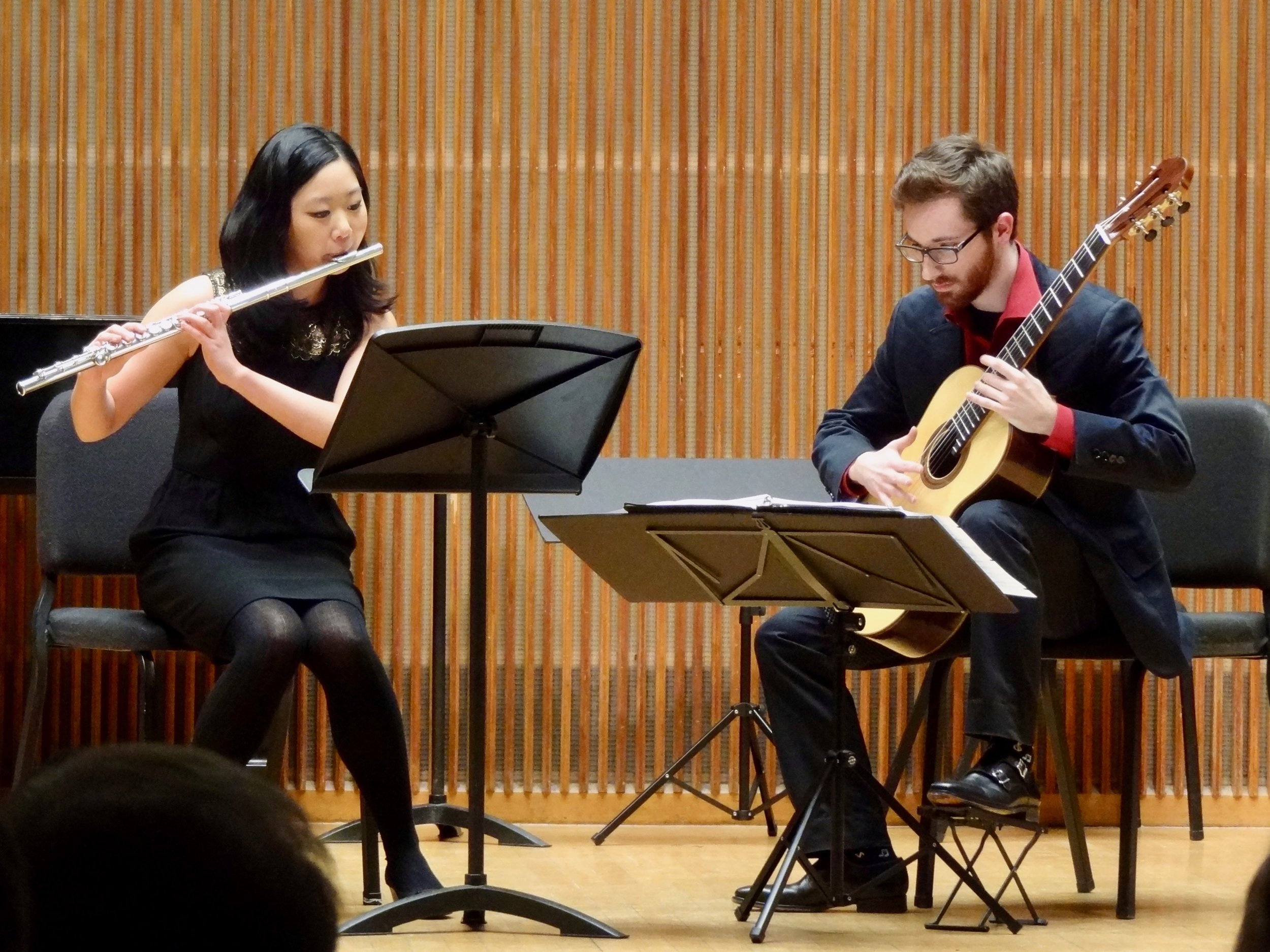Finally, Katie Kim and Brian King played the amazing Ourkouzounov Sonatine, complete with singing through the flute, the guitarist tapping and singing along, and sundry whoops, screams and hollers, all in 5/8 an 7/8. It was great!