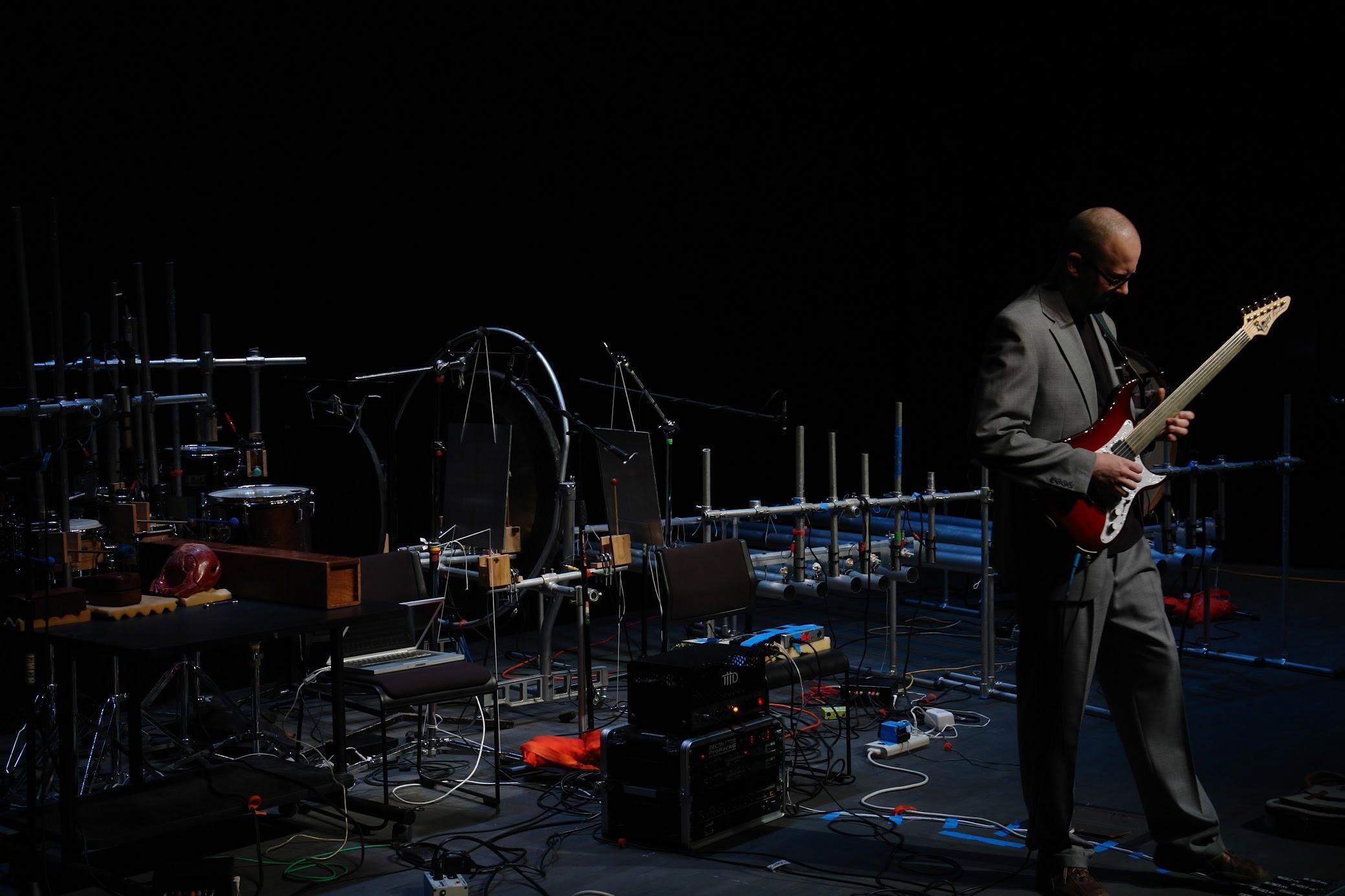 Adam performing with robot percussion array in Duoquadragintapus.