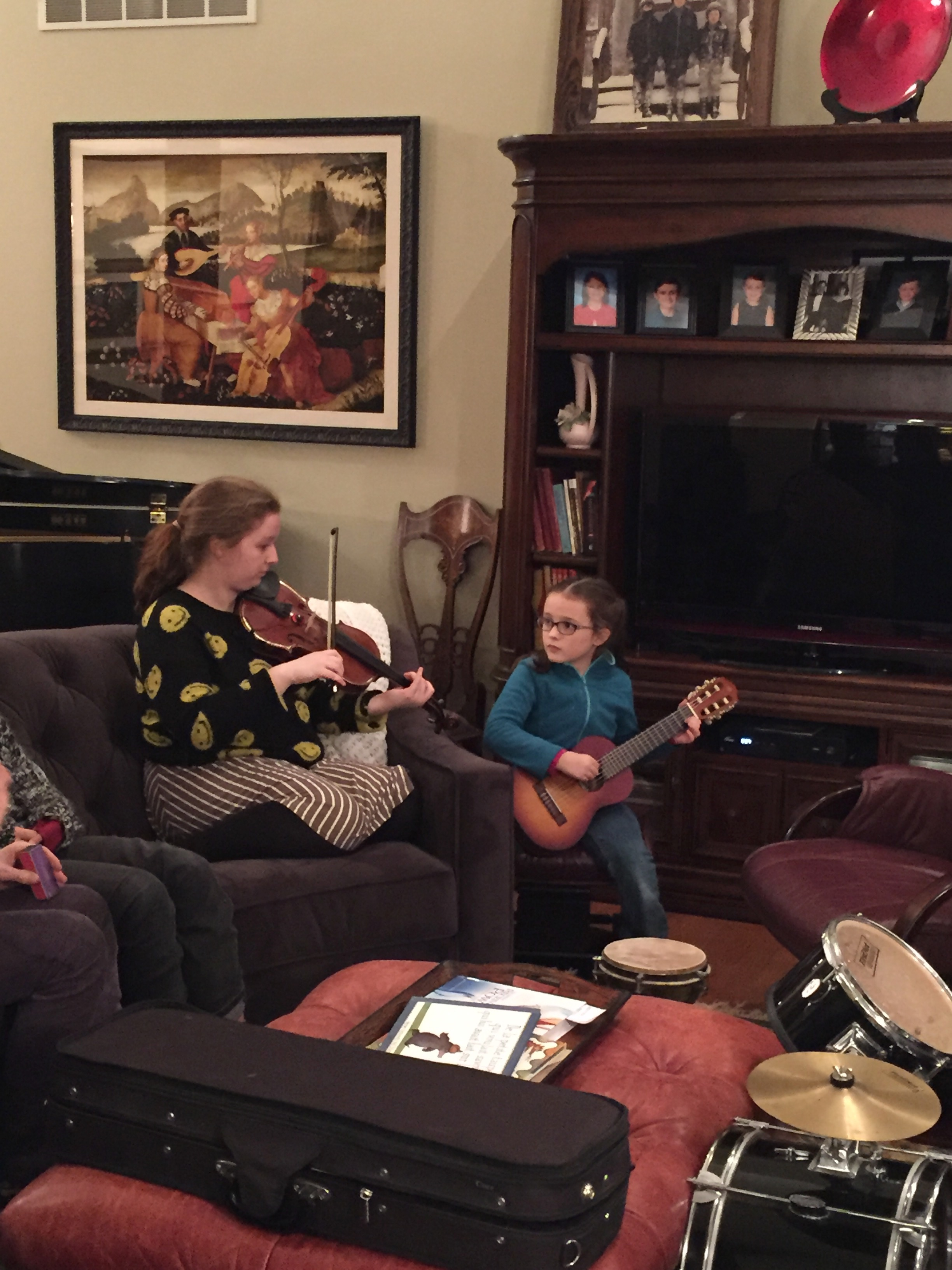 Flora, 7, who'd had a few introductory guitar lessons, was fascinated by the proceedings.