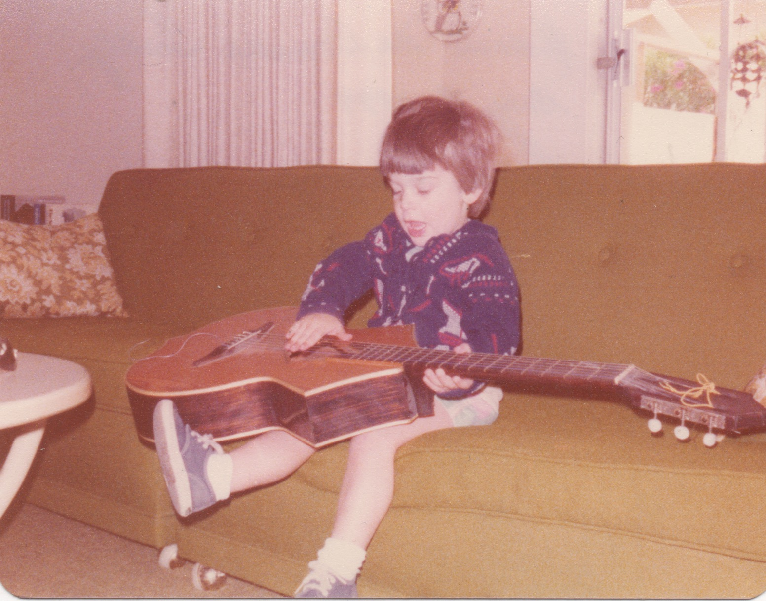 1977 - Palm Springs, CA. My grandmother must have had this guitar in her house, and at age 2 this is probably the first time I ever touched one.