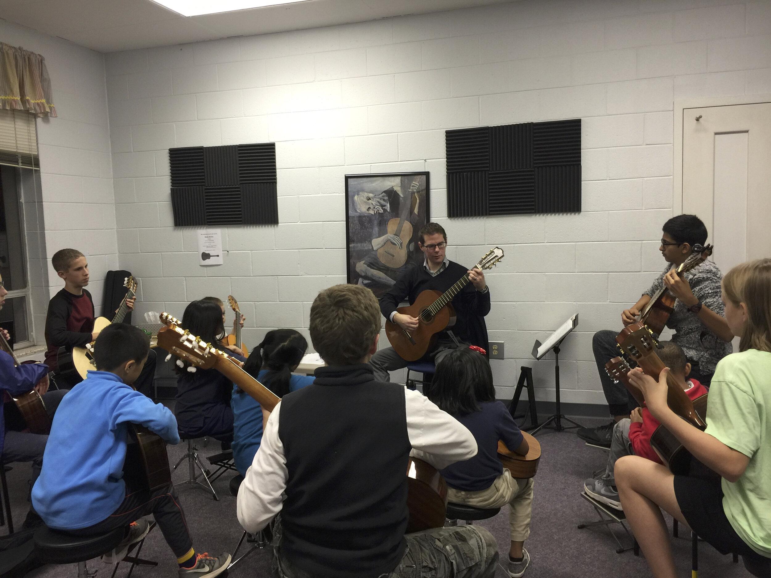 Steve teaching a Suzuki group class