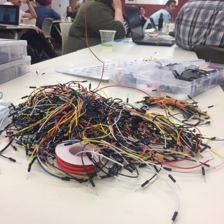 A pile of multi-colored Arduino wires on a classroom table.