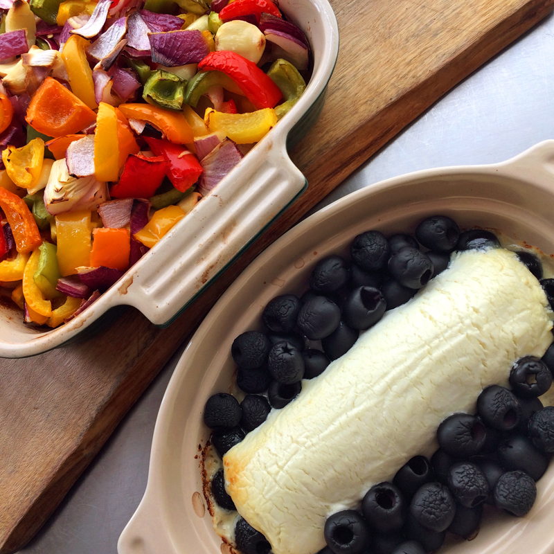 Goat cheese and roasted veggies in an oven for keto dinner recipes. Learn how to lose weight on the ketogenic diet.
