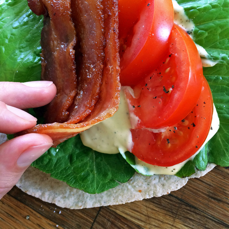 Keto wrap recipe with low carb ingredients. Blt wrap with bacon, lettuce, and tomato.