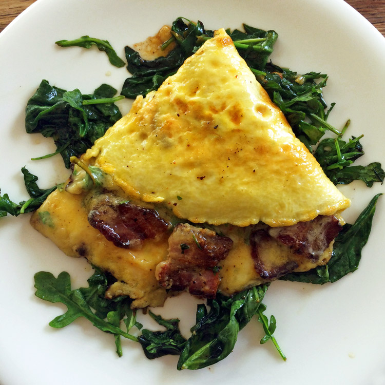 Best bacon omelette recipe for the keto diet. Make this easy bacon omelette with sauteed greens.