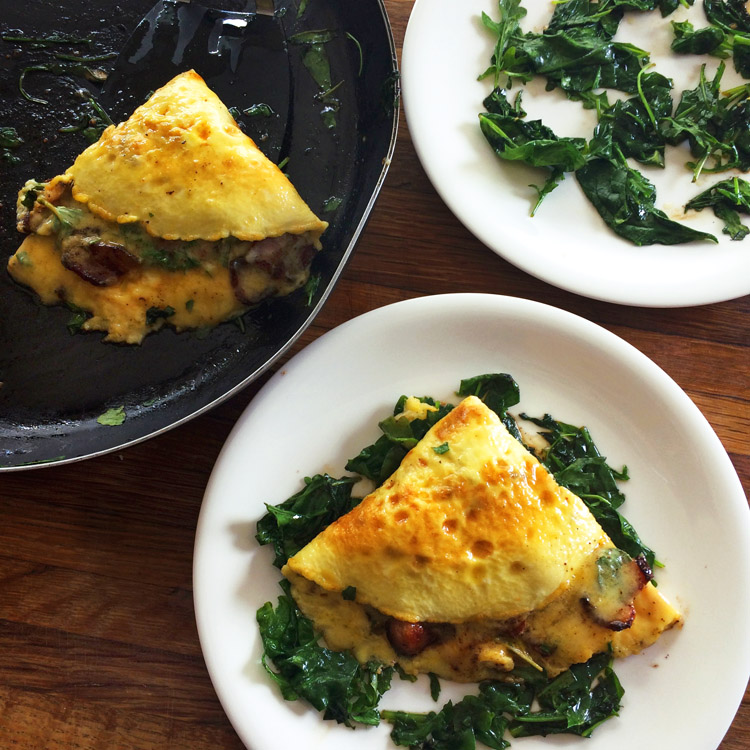 Keto bacon omelette with cheese and greens. Make this keto omelette for breakfast meals.