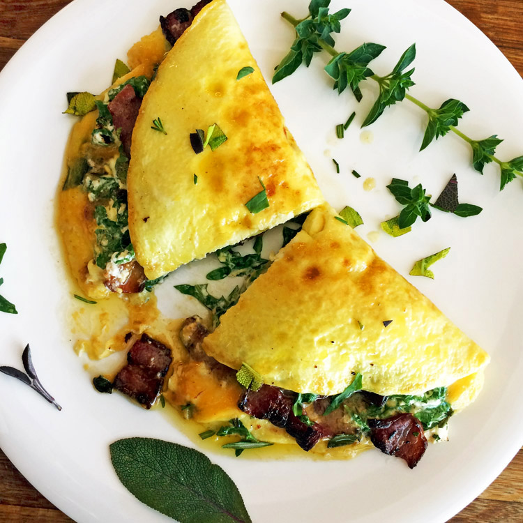 Keto breakfast recipe with bacon and cream cheese. Make this omelette for a quick meal.