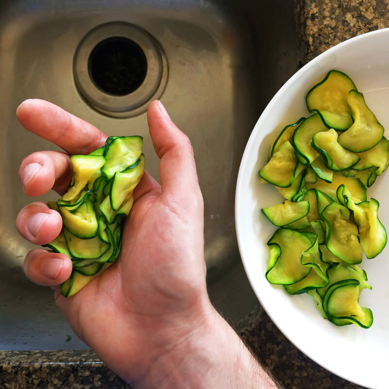 Easy scalloped zucchini recipe for the ketogenic diet. Learn how to squeeze out water from the zucchini.