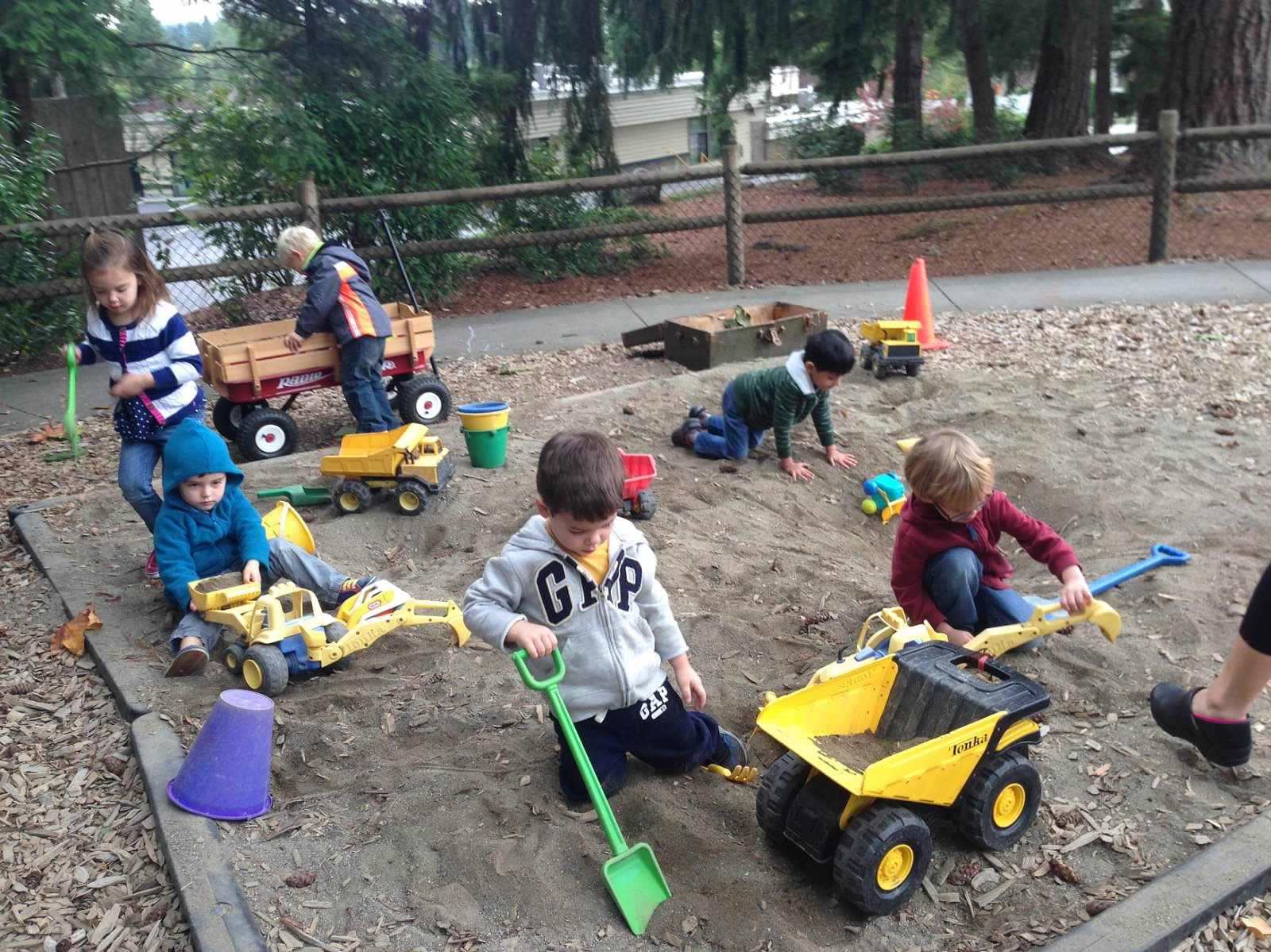 In our huge sandbox, kids use their hands and tools to explore, dig, dump, scoop, sift, and build!