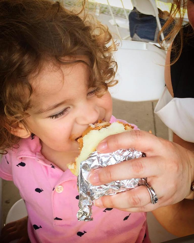 lil girl eating la tica.jpg