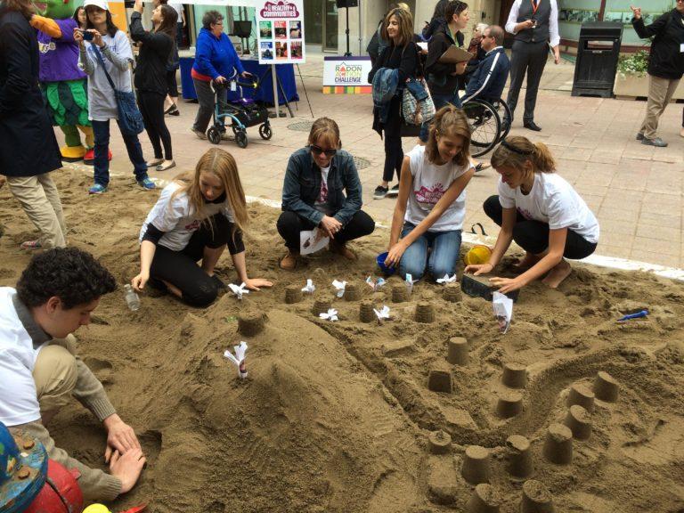 EduTOX winners join the Healthy Communities sandcastle-building team.