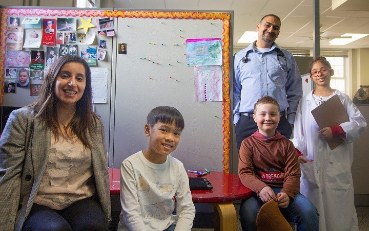 CHILD Cohort Study researchers Drs Piush Mandhane (at back) and Sukhpreet Tamana (L) with Edmonton CHILD participants (L to R) John Daniel, Colby and Sara.