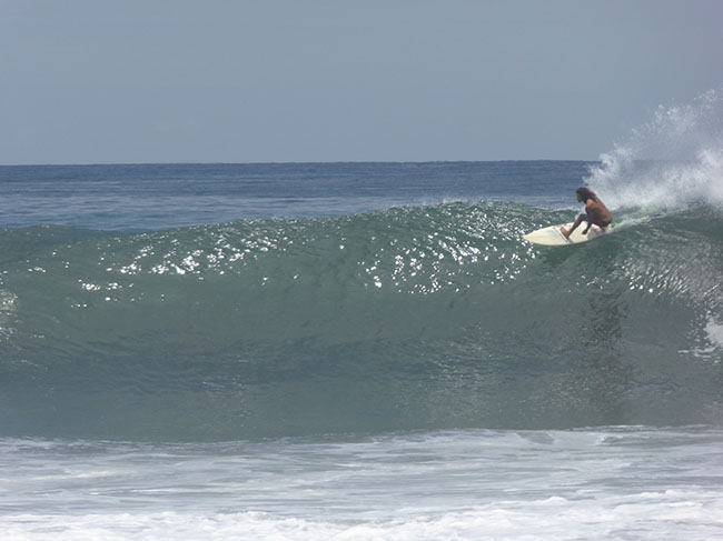 Local surfer coming off the top, Punta Roca