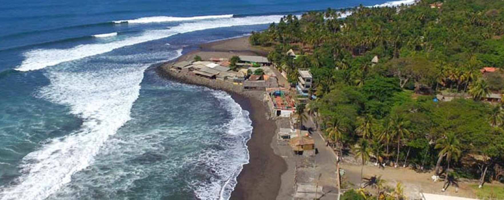 El Zonte from the air. We offer 2 great accommodation option all located right on the beach and within a minute of each other.