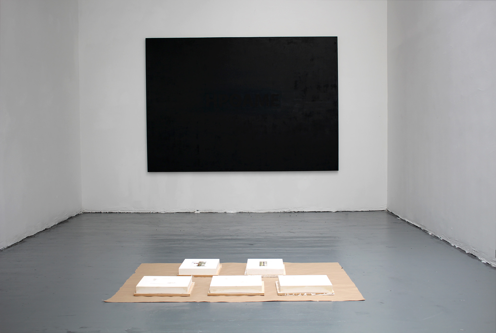 Irthame!, Study for The Structure of the Presentation of a Place, 2016, Oil on linen, Plaster, Mdf panels, Postcards, Masking tape, Craft paper, Installation view