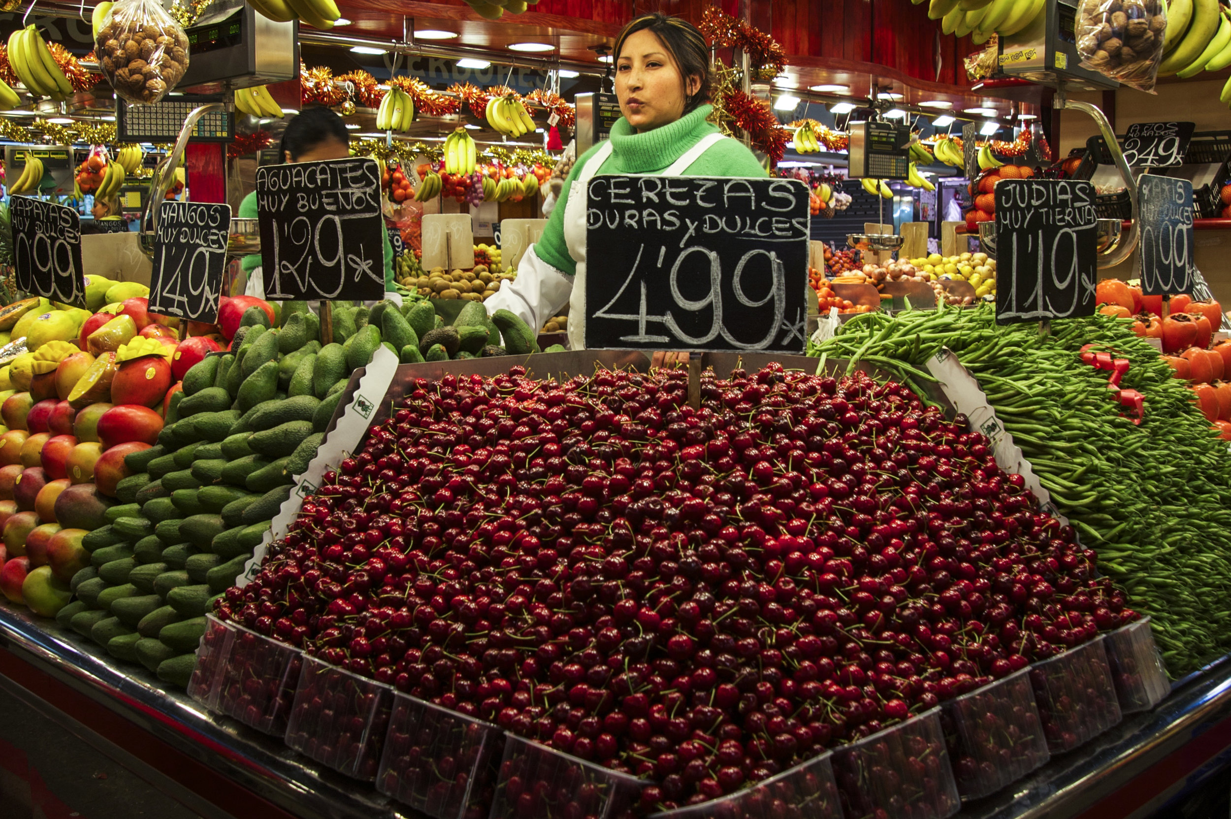 """""""Mercat de la Boqueria"""" in Barcelona a few years back. So nice to see these fruits free from shrink-wrap and styrofoam. Chalkboards seem to be enough too, no need for stickers in each and every fruit."""