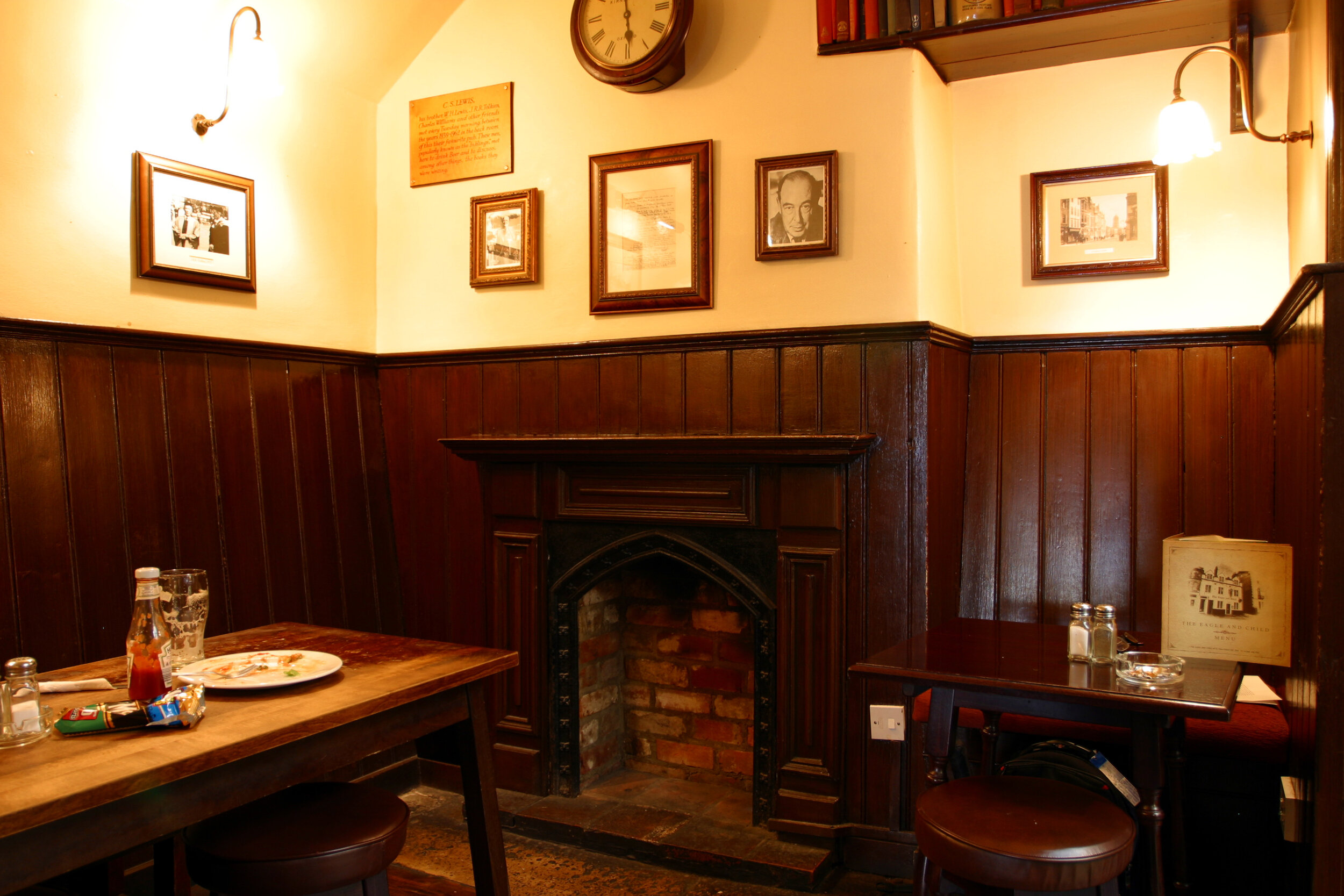 A corner of The Eagle and Child pub, formerly the landlord's sitting-room where the Inklings met. [See photo credit below]