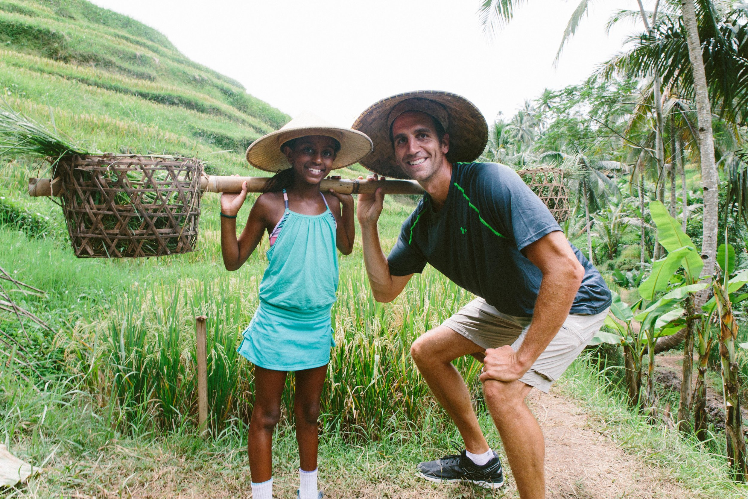 Kya and Dad hard at work harvesting the rice in the beautiful terraces in Ubud. It takes 3.5-4 months from the initial planting of the seedling until it is time to harvest. Many families here in Indonesia use their land to grow white, red, and black rice.