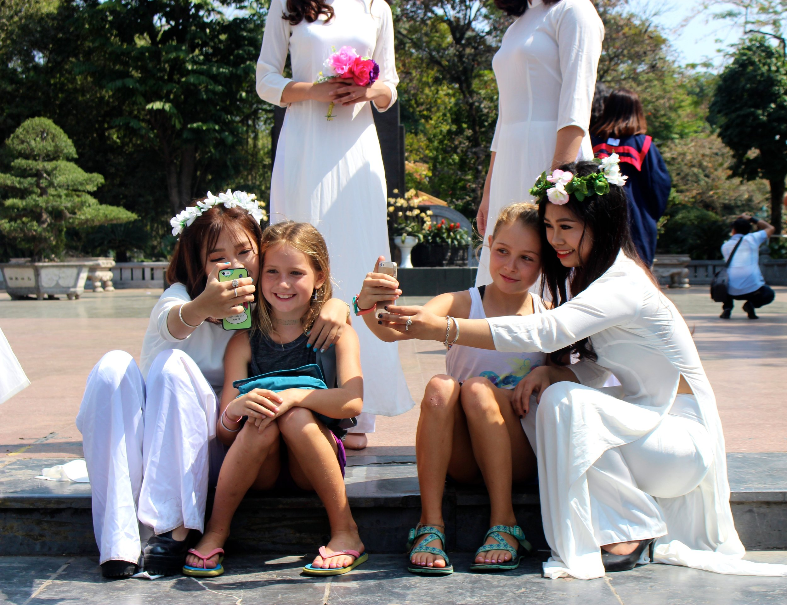 While out roller blading and enjoying the beautiful weekend weather at the Hanoi city center square, the girls quickly became fan favorites of the local High School graduating class.Lots of laughs and selfies were shared with this group of local Vietnamese girls.