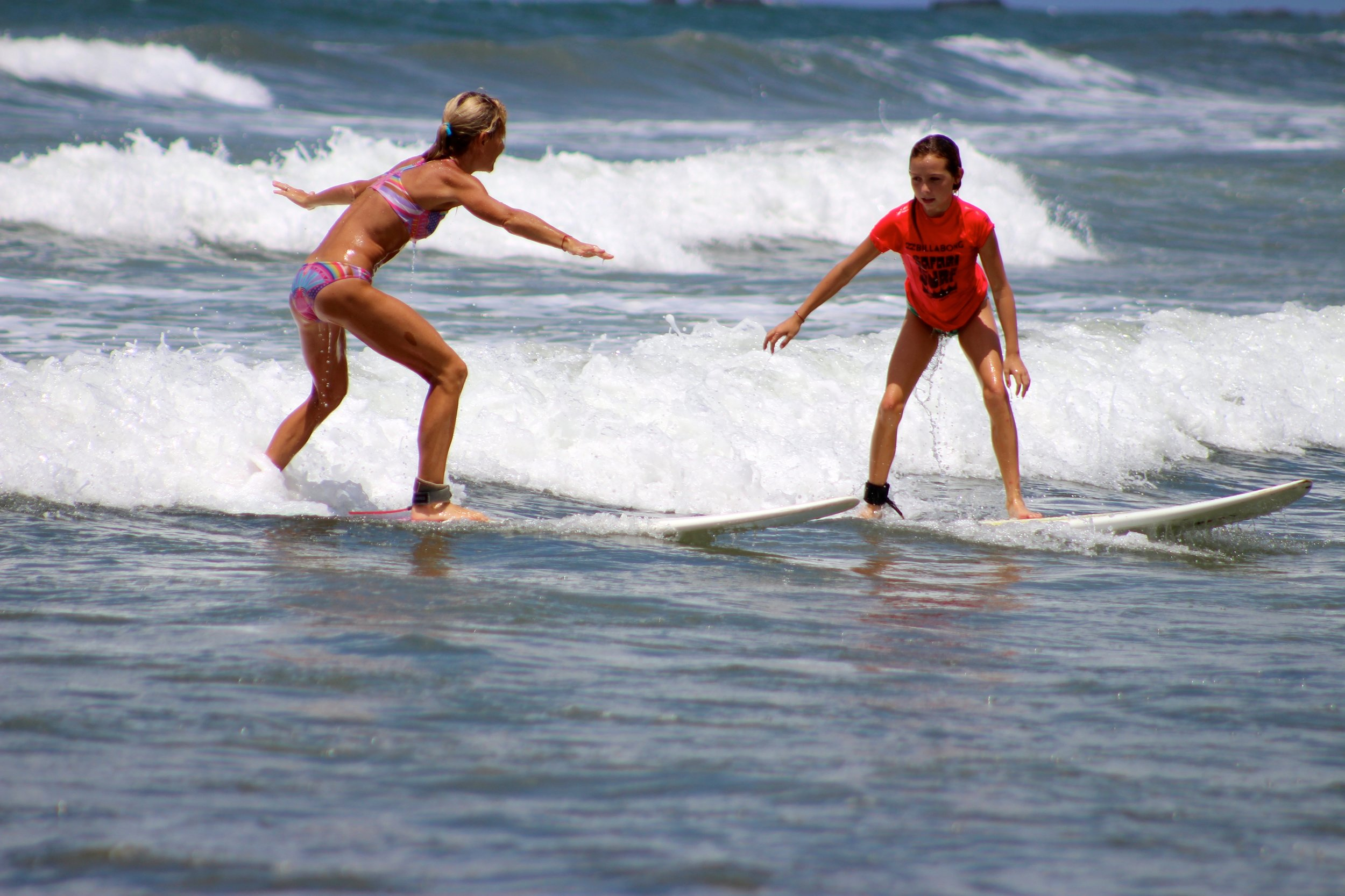 Surfing the amazing and endless waves on Playa Guiones in Nosara, Costa Rica.